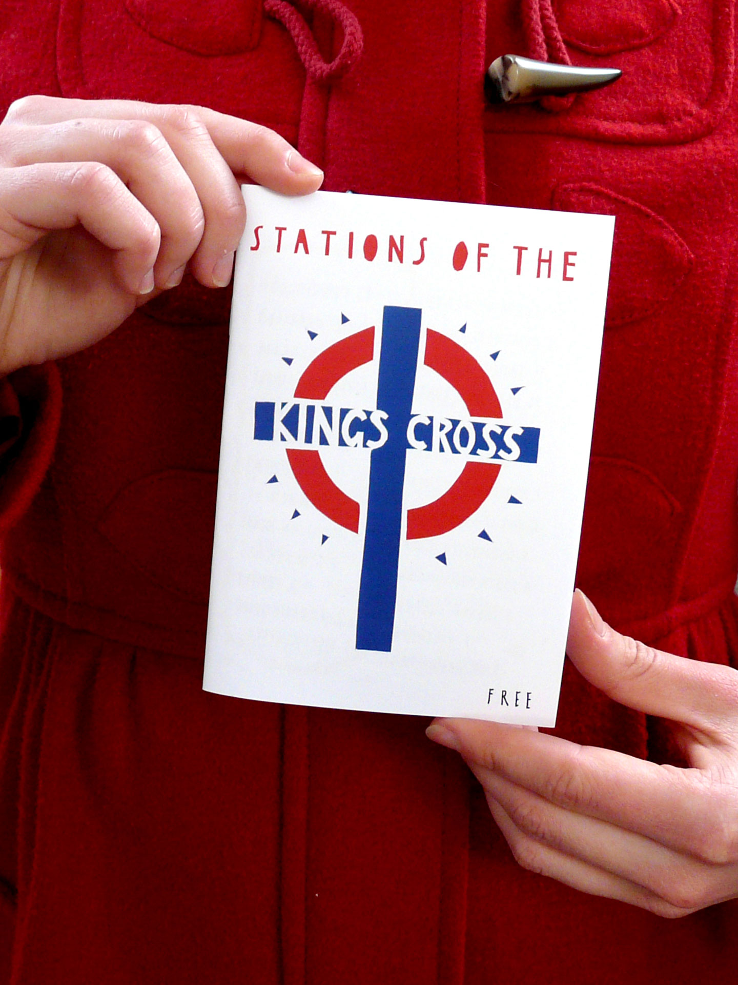 Stations of the Kings Cross booklet being held